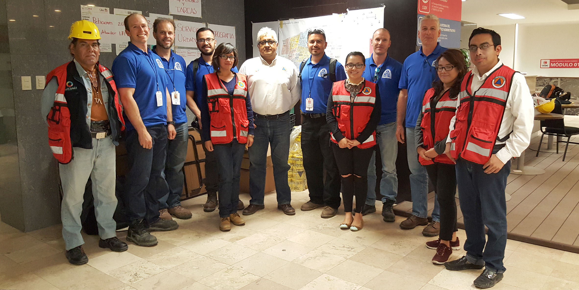 SEAOSC Safer Cities Reconnaissance Team poses with building officials and volunteers from the Benita Jaurez District of Civil Protection