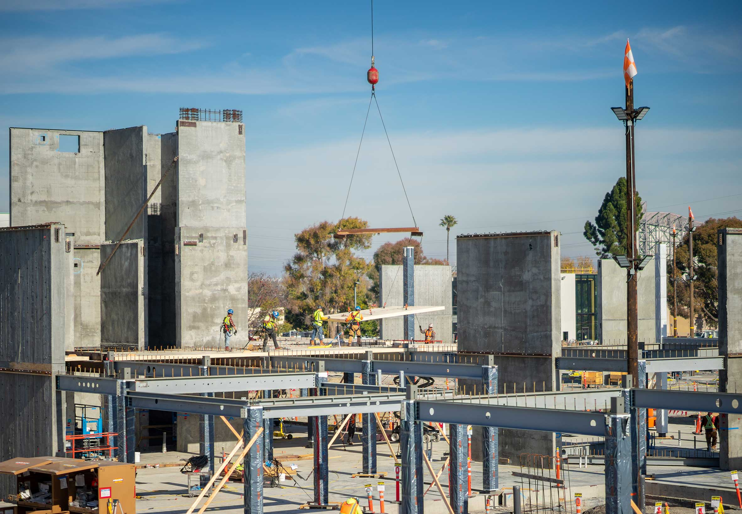 Construction workers install a craned-in CLT panel on second level f corporate campus in Mountain View