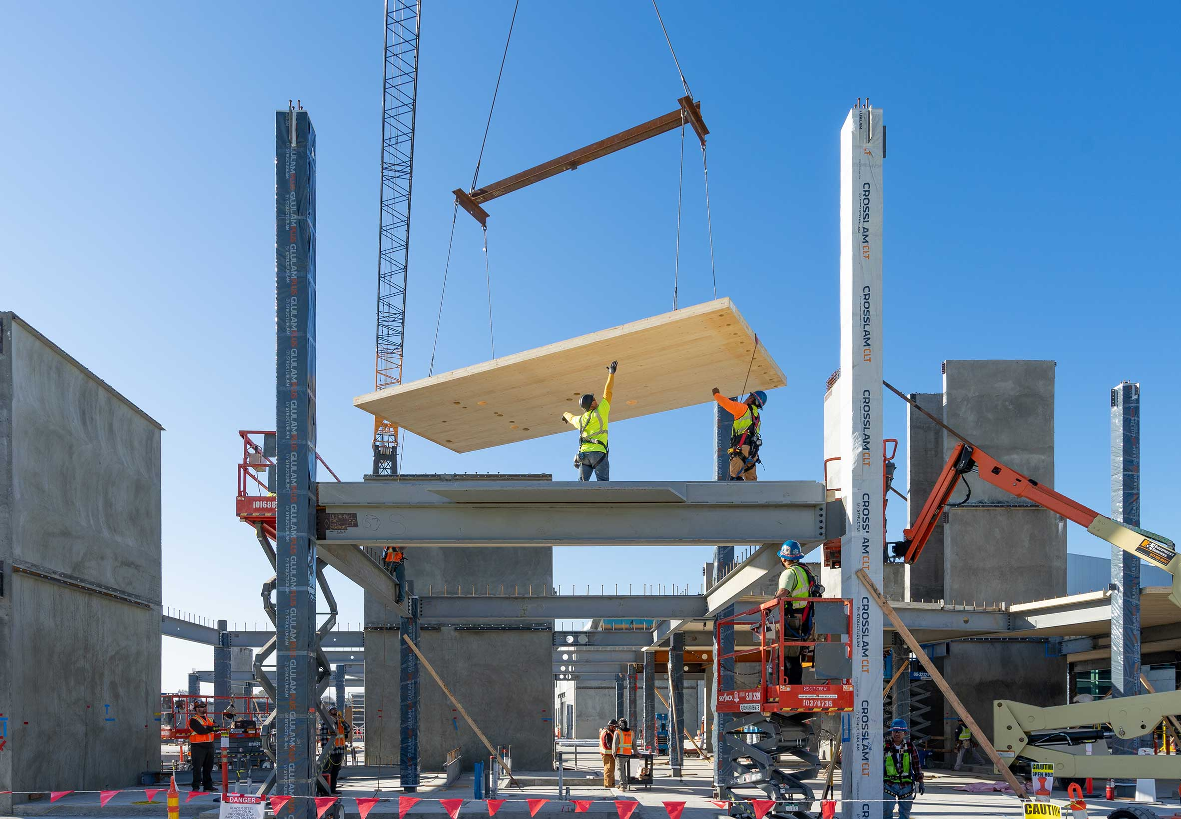 Construction workers install a CLT panel at Confidential Corporate Campus