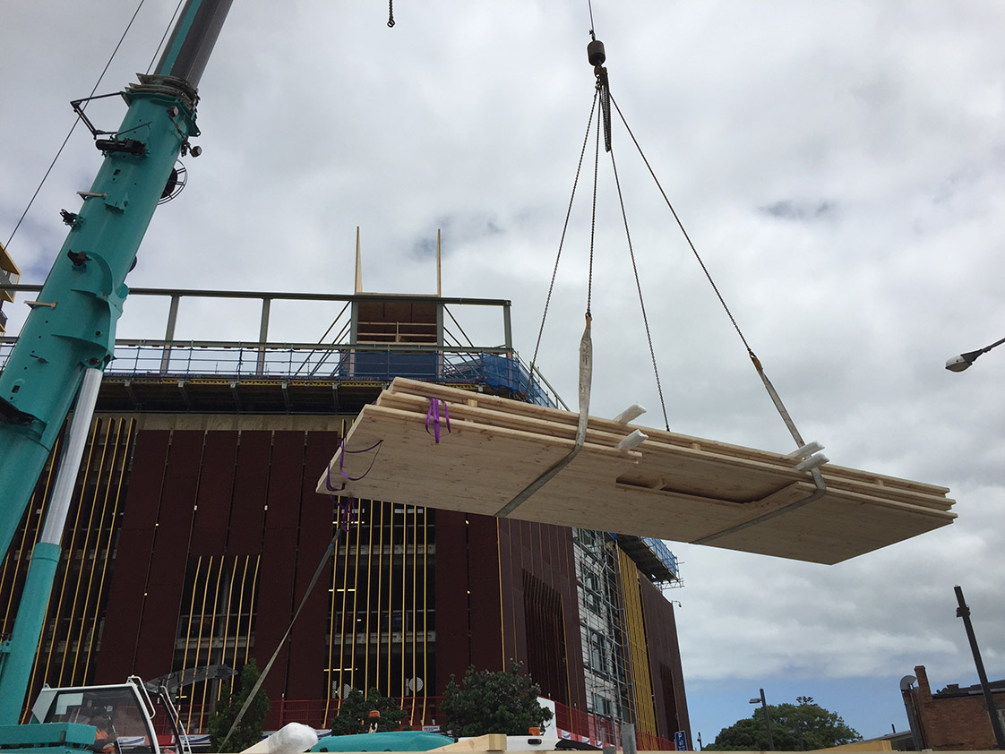 Mass timber hoisted onto site
