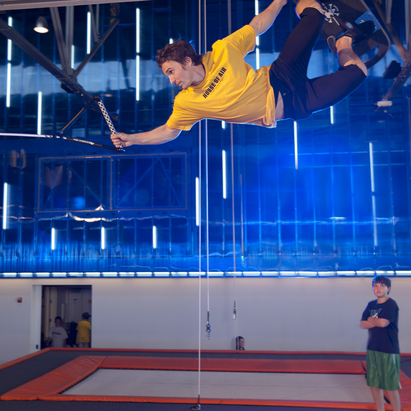 Presidio House of Air interior: athlete does freestlye aerial maneuver