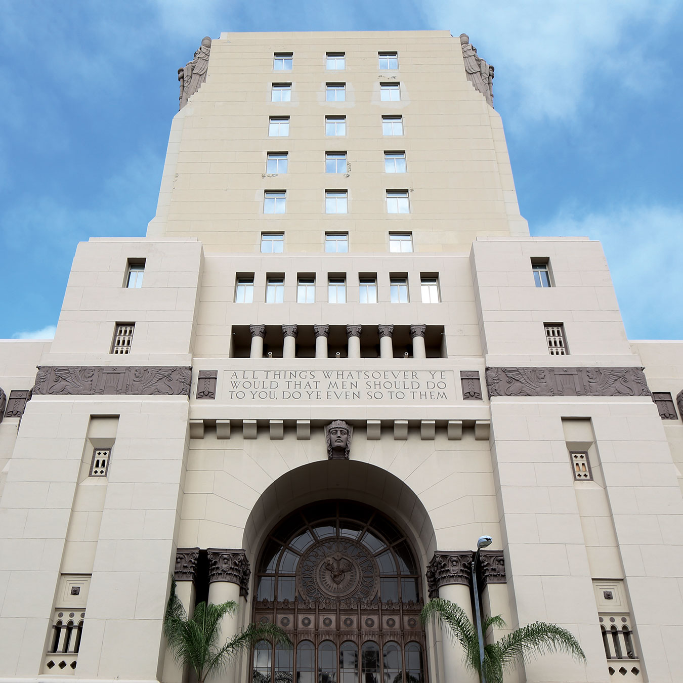 The MacArthur Exterior Facade and Tower in Los Angeles with Blue Sky