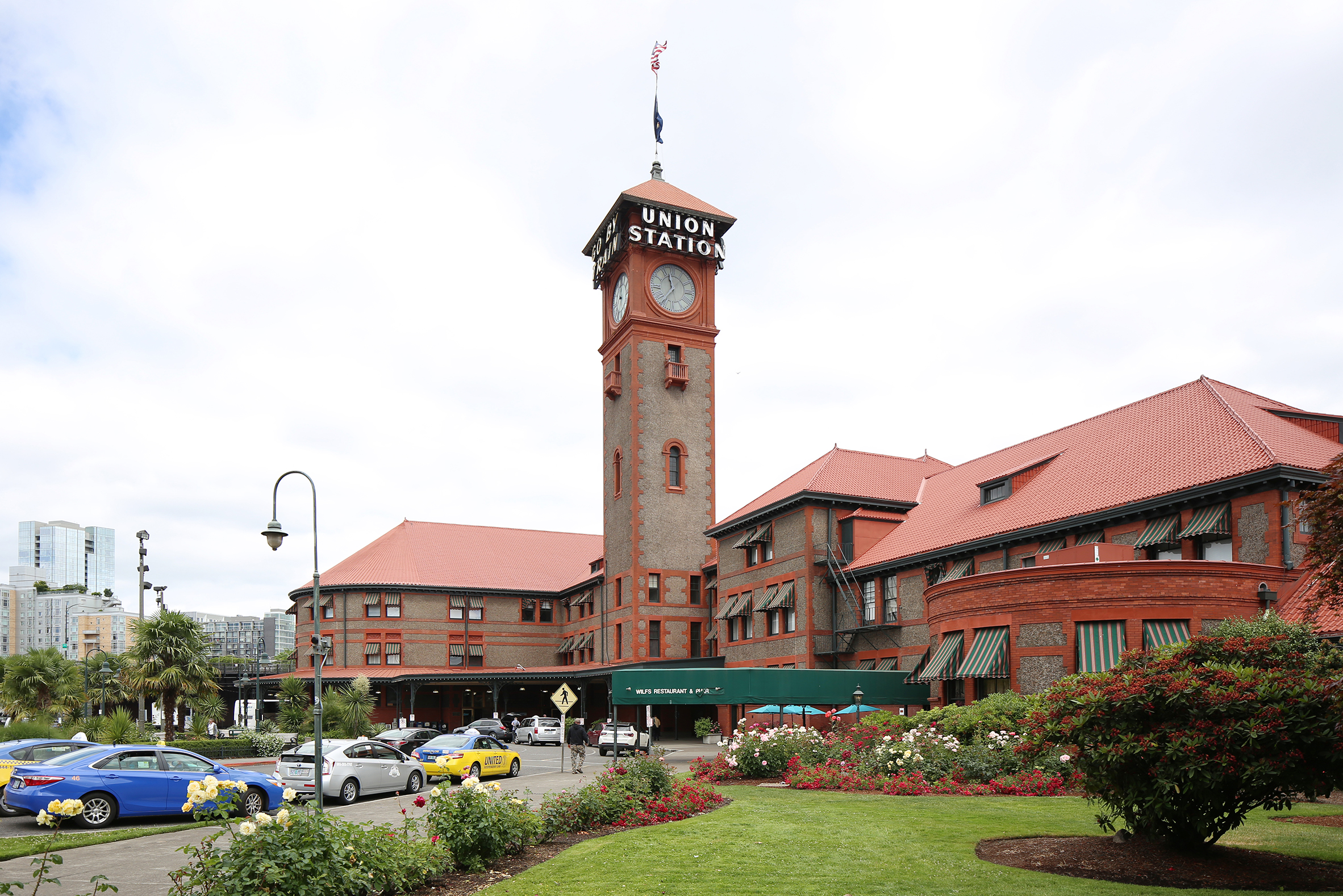 Exterior of URM Building Portland Union Station with Taxis and Lawn