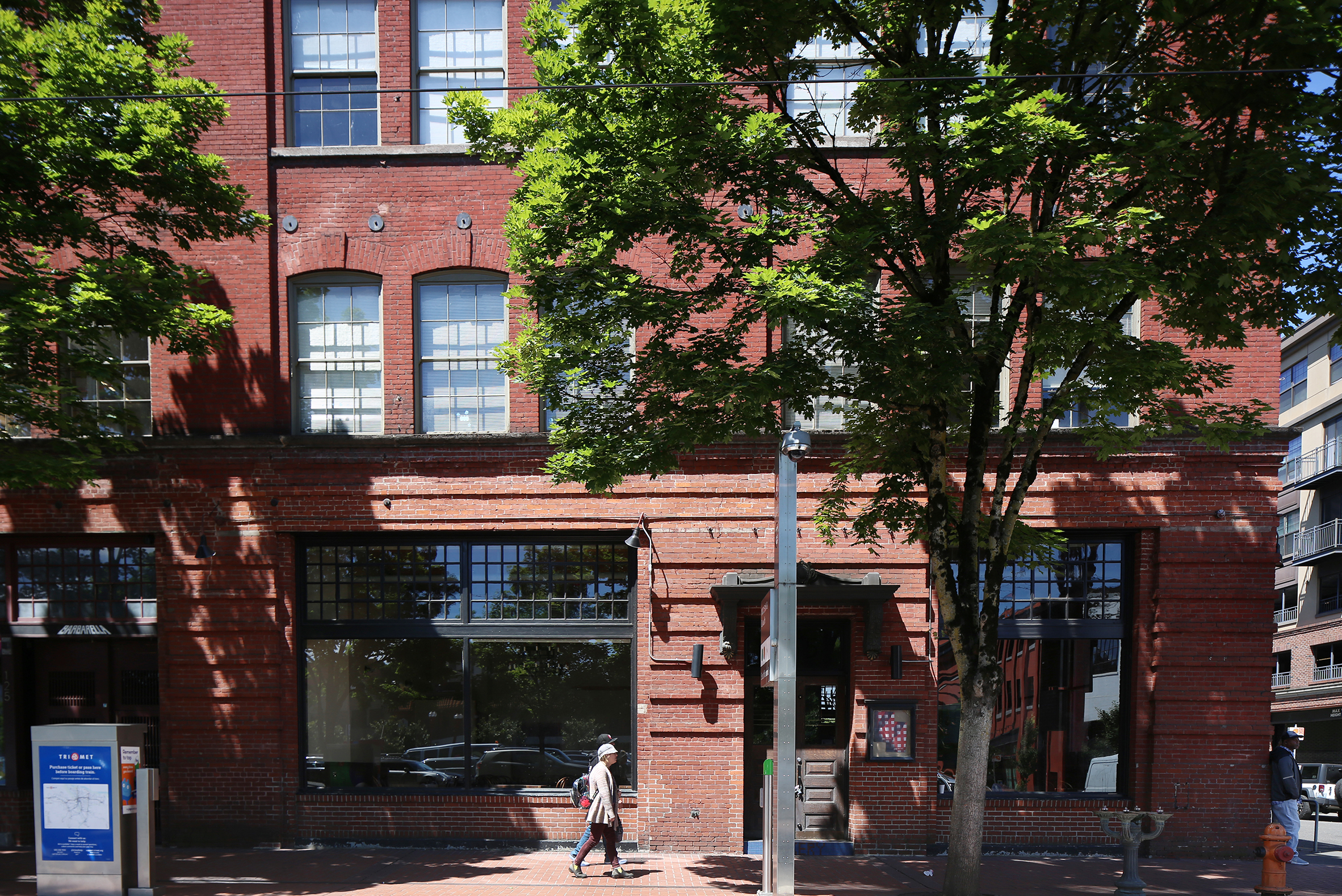 Brick Facade of URM Building in Downtown Portland with Pedestrians by Metro