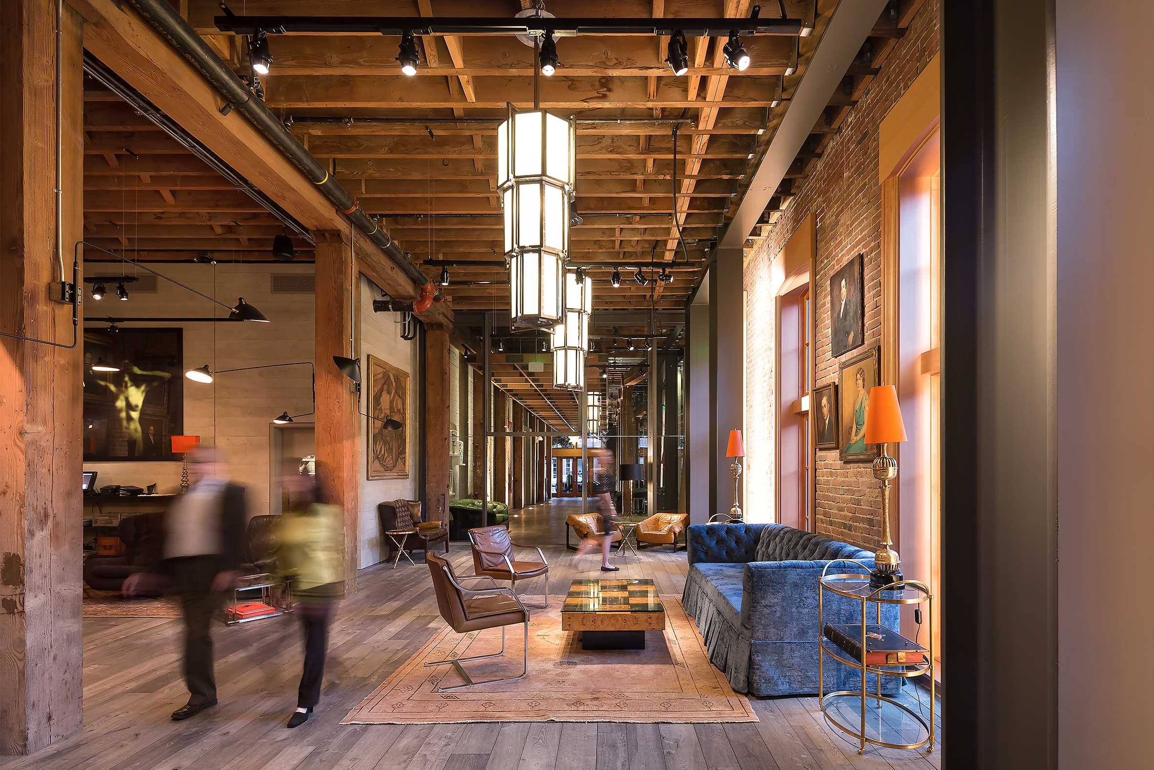 Interior of The Battery Social Club in San Francisco with Brick Masonry Walls and Wooden Floor/Ceiling and Furniture