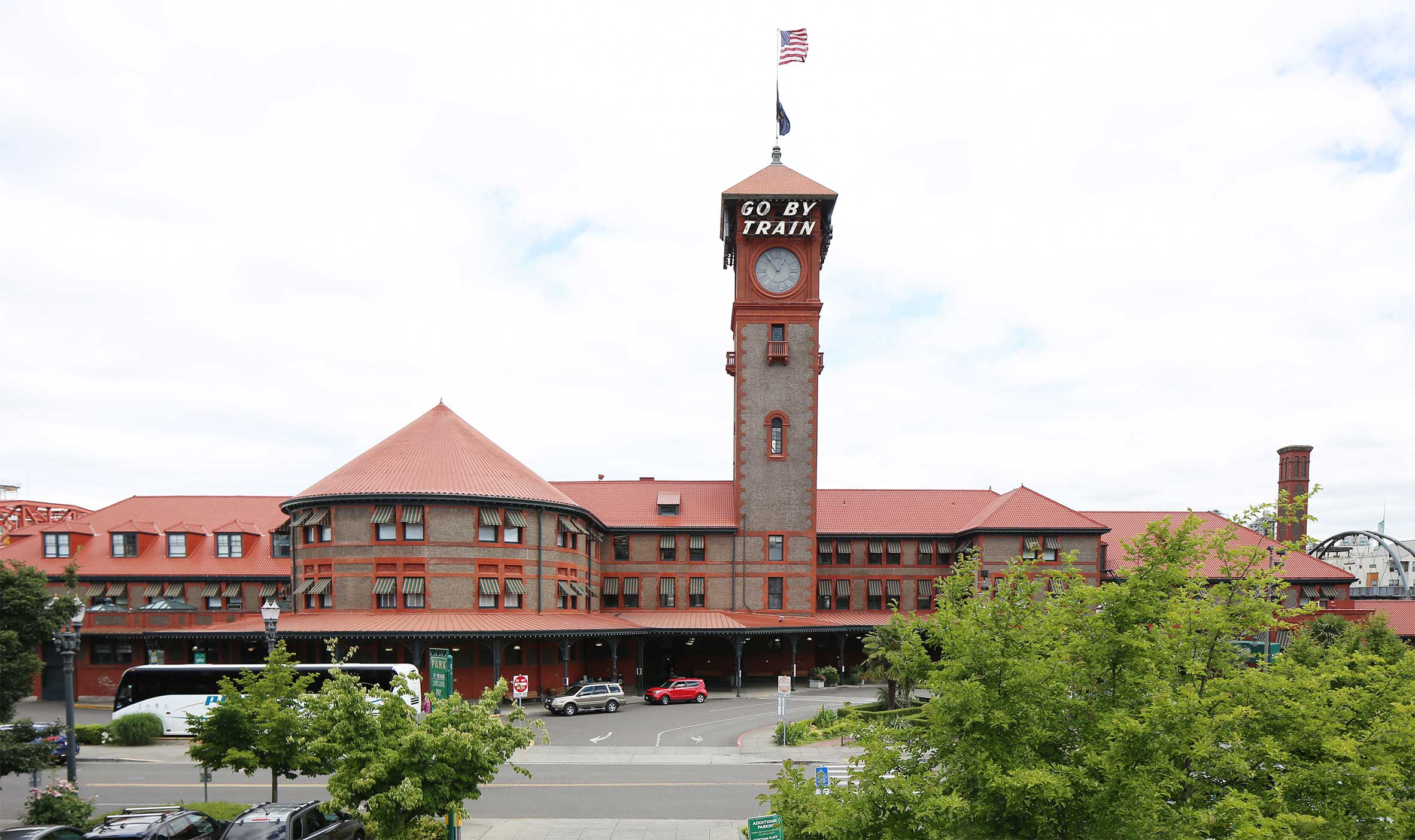 Exterior of Portland Union Station with Flag and Parking Lot and Trees